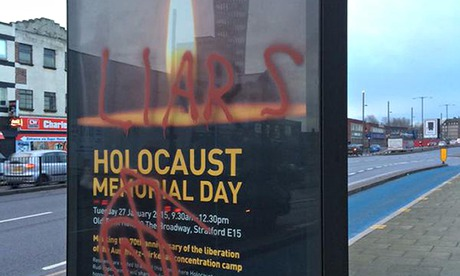 Police investigate after a Holocaust memorial day poster is defaced in Stratford, east London
