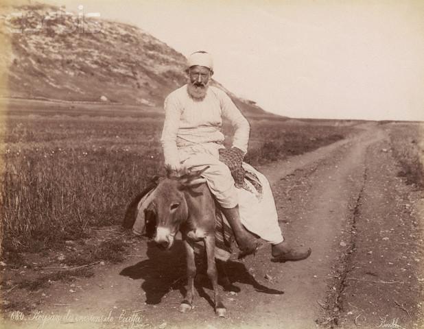 Israeli Man Riding a Donkey